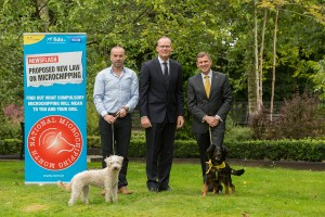 Finbarr Heslin MRCVS, www.fido.ie; Simon Coveney T.D. , Minister for Agriculture, Food & The Marine and Mark Beazley, Executive Director, Dogs Trust, with Cara and lady.  Picture Dylan Vaughan.